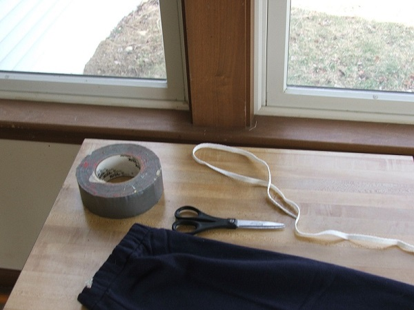 Figure 1. Materials: sweatpants, scissors, shoestring and duct tape.